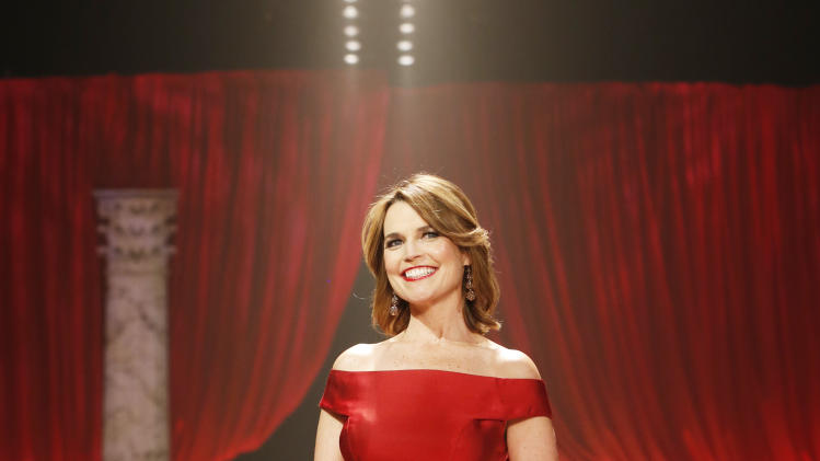 Savannah Guthrie walks the runway at the Red Dress Collection 2013 Fashion Show, on Wednesday, Feb. 6, 2013 in New York. (Photo by John Minchillo/Invision/AP)