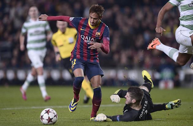 FC Barcelona's Neymar, left, duels for the ball against Celtic's goalkeeper Fraser Foster, below, during a Champions League soccer match group H at the Camp Nou in Barcelona, Spain, Wednesday,