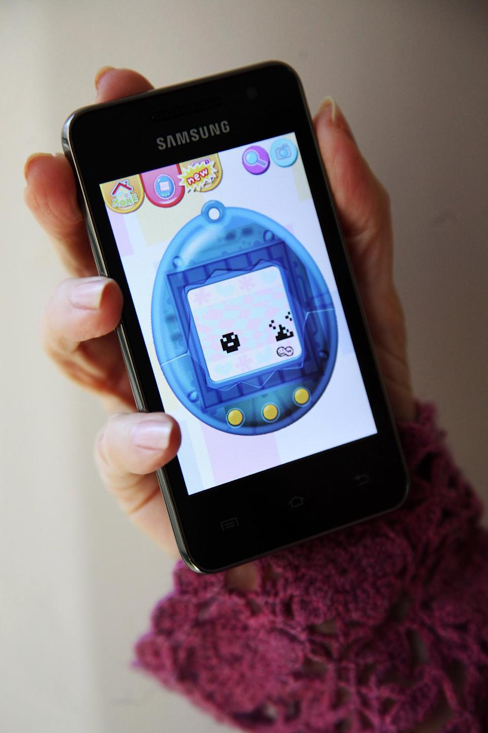 "The mobile app ""Tamagotchi L.I.F.E."" by developer/publisher Bandai America Inc./Sync Beatz Entertainment is shown displayed on a smartphone on Wednesday, Feb. 13, 2013, in Los Angeles. (AP Photo/Richard Vogel)"