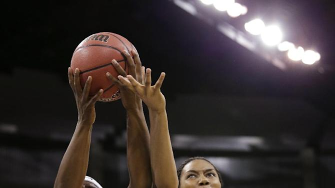 California's Talia Caldwell (33) and Georgia's Tamika Willis reach for a rebound during the first half in a regional final in the NCAA women's college basketball tournament, Monday, April 1, 2013, in Spokane, Wash. (AP Photo/Elaine Thompson)