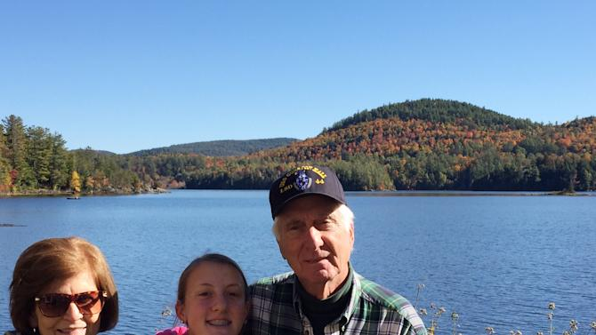 In this Oct. 11, 2015, photo, provided by Michele Gange Bonner, Lauren Bonner, center, poses between her grandparents Camille and Claude Gange at Paradox Lake, N.Y. Lauren, 13, interviewed her grandparents ahead of the StoryCorps Great Thanksgiving Listen oral history project. (Michele Gange Bonner via AP)