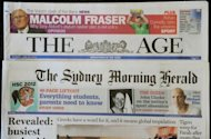 "The front pages of Australian media giant Fairfax's newspapers ""The Age"" and ""The Sydney Morning Herald"" are displayed in Sydney on June 18, 2012. The Australian media sector is enduring a turbulent period, with the two major newspaper groups Fairfax and Rupert Murdoch's News Limited both flagging large job cuts as they grapple with the challenges of the digital transition"
