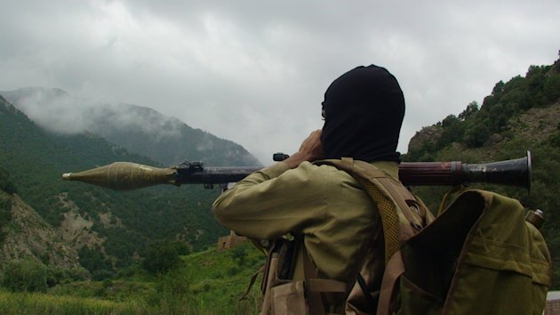 In a photo made Aug. 5, 2012, a Pakistani Taliban militant holds a rocket-propelled grenade at the Taliban stronghold of Shawal, in Pakistani tribal region of Waziristan along the Afghanistan border. Pakistan's decision to launch an operation against Islamist militants holed up in a key tribal sanctuary along the Afghan border has sparked rare optimism among U.S. officials who have been demanding action for years. (AP Photo/ Ishtiaq Mahsud)