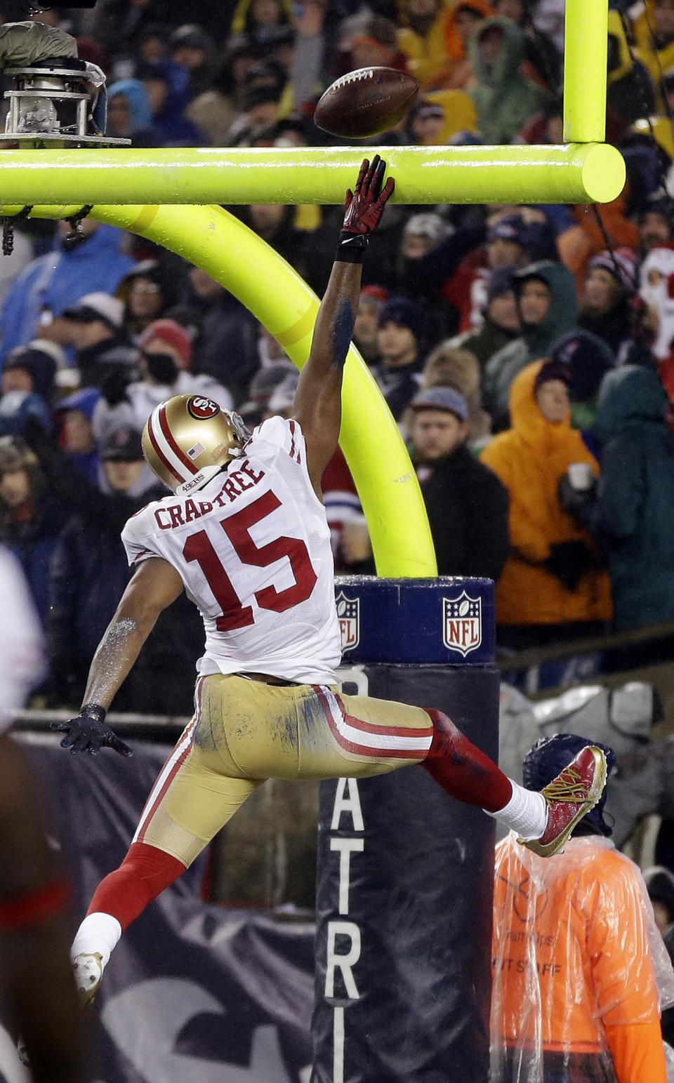San Francisco 49ers wide receiver Michael Crabtree (15) spikes the ball over the goal post after scoring a touchdown against the New England Patriots in the third quarter of an NFL football game in Foxborough, Mass., Sunday, Dec. 16, 2012. (AP Photo/Elise Amendola)