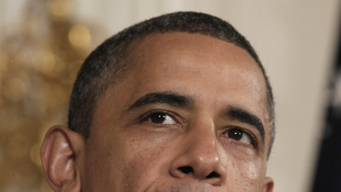 President Barack Obama pauses as he speaks in the State Dining Room of the White House in Washington, Monday, Aug. 8, 2011.  (AP Photo/Carolyn Kaster)