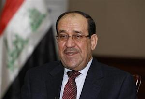 Iraq's Prime Minister Nuri al-Maliki speaks during an interview with Reuters in Baghdad January 12, 2014. REUTERS/Thaier Al-Sudani/Files