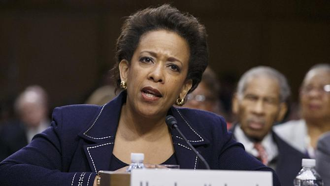 """In this Jan. 28, 2015 file photo, Attorney General nominee Loretta Lynch testifies on Capitol Hill in Washington. President Barack Obama on Friday said it was """"crazy"""" and """"embarrassing"""" the way the Republican-led Senate has held up confirmation of his attorney general nominee, Loretta Lynch. """"What are we doing here?"""" Obama said. """"I have to say there are times when the dysfunction in the Senate just goes too far. This is an example of it. It's gone too far. Enough. Enough. """"Call Loretta Lynch for a vote,"""" he said emphatically. """"Get her confirmed.""""  (AP Photo/J. Scott Applewhite, File)"""