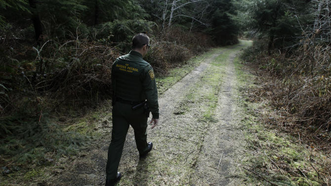 U.S. Border Patrol Agent Chris Dyer walks through a forested area near Forks, Wash., Thursday, March 17, 2011 to show a reporter where he once pursued an immigrant accused of stabbing a man to death in a fight. Relations between the immigrant population of Forks -- many who work in the surrounding forests -- and the Border Patrol have been strained for many months, and tensions have increased due to the recent death of an immigrant who was trying to evade a Border Patrol agent. (AP Photo/Ted S. Warren)