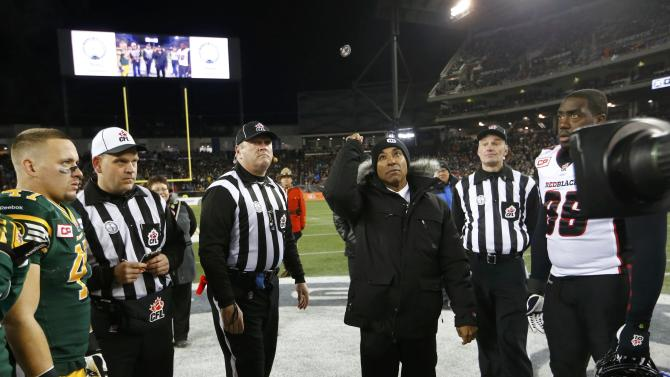 CFL commisssioner Jeffrey Orridge throws the coin toss prior to the CFL's 103rd Grey Cup championship football game between the Ottawa Redblacks and the Edmonton Eskimos in Winnipeg