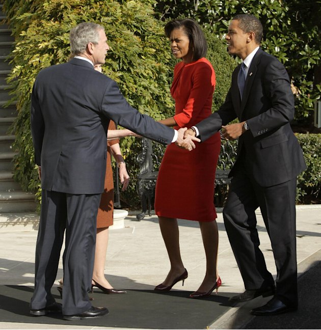 FILE - In this Nov. 10, 2008 file photo, President and Mrs. Bush greet President-elect Obama and Michelle Obama at the White House in Washington. President Barack Obama frequently blames President Geo