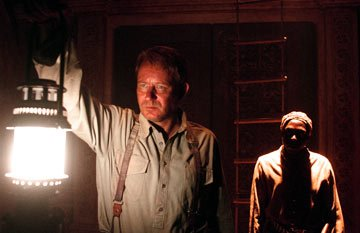 Stellan Skarsgard and Andrew French in Warner Brothers' Exorcist: The Beginning