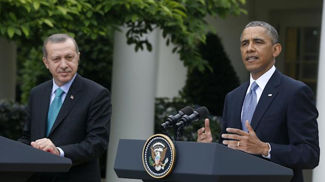 President Barack Obama, accompanied by Turkish Prime Minister Recep Tayyip Erdogan gestures during their joint news conference, Thursday, May 16, 2013, in the Rose Garden of the White House in Washington. (AP Photo/Charles Dharapak)