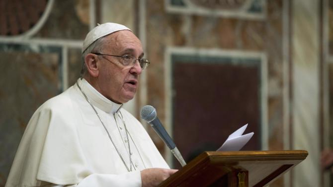 Pope Francis makes his speech during an audience with the diplomatic corps at the Vatican