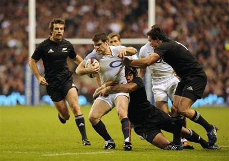 England's Hipkiss is challenged by New Zealand's Nonu during their international rugby union match at Twickenham Stadium in London