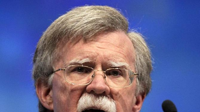 FILE - In this April 13, 2012 file photo, former U.N. Ambassador John Bolton speaks at the National Rifle Association convention in St. Louis. Negotiators at the United Nations are working against a Friday deadline to put final touches on a treaty cracking down on the $60 billion global illicit trade in small arms, a move aimed at curbing violence in some of the most troubled corners of the world. In the United States, gun activists denounce it as an end-run around their constitutional right to bear arms. (AP Photo/Michael Conroy, File)