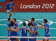 Players of Italy celebrate after defeating Bulgaria in the men&#39;s volleyball bronze medal match of the London 2012 Olympics Games, in London on August 12, 2012.     AFP PHOTO / ALBERTO PIZZOLI
