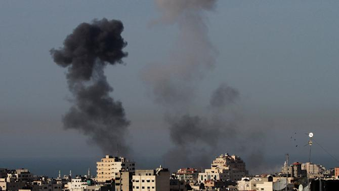 Smoke rises from an explosion following an Israeli airstrike in Gaza City, Saturday, March 10, 2012. The worst violence between Israel and the Gaza Strip in nearly a year entered its second day on Saturday, as Israeli aircraft killed 14 militants, according to Palestinian health officials. Militants responded by firing nearly 100 rockets, seriously wounding an Israeli civilian. (AP photo/Hatem Moussa)