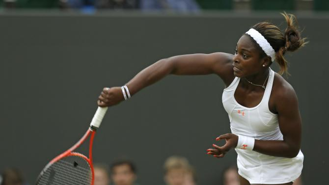 Sloane Stephens of the United States serves to Petra Cetkovska of the Czech Republic during their Women's singles match at the All England Lawn Tennis Championships in Wimbledon, London, Friday, June 28, 2013. (AP Photo/Alastair Grant)