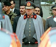 "File photo of Augusto Pinochet as Chilean leader and commander of the Chilean Armed Forces in Santiago in 1997. Chile charged two former officers of Pinochet's military dictatorship with being the ""co-authors"" of the torture that killed the father of former president Michelle Bachelet"