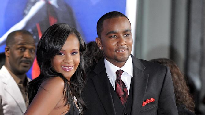 """FILE - In this Aug. 16, 2012 file photo, Bobbi Kristina Brown, right, and Nick Gordon attend the Los Angeles premiere of """"Sparkle"""" at Grauman's Chinese Theatre in Los Angeles. The daughter of late singer and entertainer Whitney Houston was found Saturday, Jan. 31, 2015, unresponsive in a bathtub by her husband and a friend and taken to an Atlanta-area hospital. The incident remains under investigation.  (Photo by Jordan Strauss/Invision/AP, File)"""