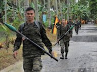 File photo shows Moro Islamic Liberation Front (MILF) rebels at Camp Darapan on Mindanao island in 2011. The Philippine government and MILF announced Sunday they have agreed a plan to end a decades-long separatist insurgency that has killed more than 150,000 people