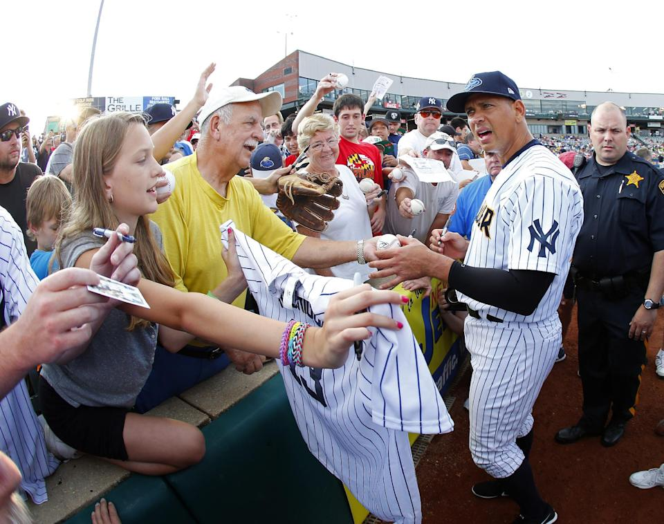 New York Yankees third baseman Alex Rodriguez (13) signs autographs before a Class AA baseball game with the Trenton Thunder against the Reading Phillies Saturday, Aug. 3, 2013, in Trenton, N.J. (AP Photo/Rich Schultz)