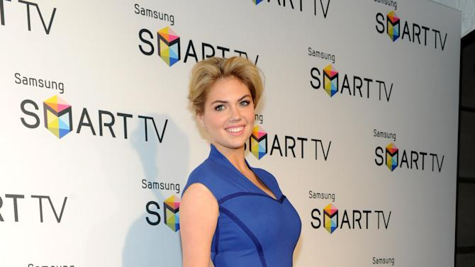 IMAGE DISTRIBUTED FOR CLIENT NAME - Model Kate Upton helps Samsung showcase its 2013 line of Smart TVs, Wednesday, March 20, 2013, in New York.  Samsung's new line allows the viewer to discover more of the TV they love with a smarter and more personalized experience.  (Photo by Diane Bondareff/Invision for Samsung/AP Images)