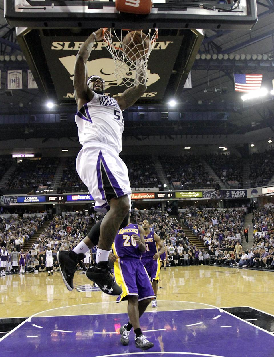 Sacramento Kings forward James Johnson, let, dunks over Los Angeles Lakers guard Jodie Meeks, right, during the second half of an NBA basketball game in Sacramento, Calif., Wednesday, Nov. 21, 2012. The Kings won 113-97. (AP Photo/Rich Pedroncelli)