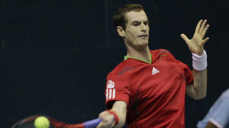 Andy Murray of Great Britain returns the ball to Grigor Dimitrov of Bulgaria during their quarterfinal match of the Thailand Open tennis tournament in Bangkok, Thailand Friday, Sept. 30, 2011.(AP Photo/Sakchai Lalit)