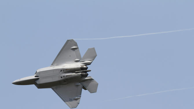 An Air Force F-22 Raptor goes through maneuvers during a demonstration at Langley Air Force Base in Hampton, Va., Monday, April 30, 2012. Air Force Gen. Mike Hostage, commander of Air Combat Command, said Monday that the F-22 Raptor is vital to the Air Force and that the service continues to search what is causing hypoxia like symptoms in some pilots.   (AP Photo/Steve Helber)