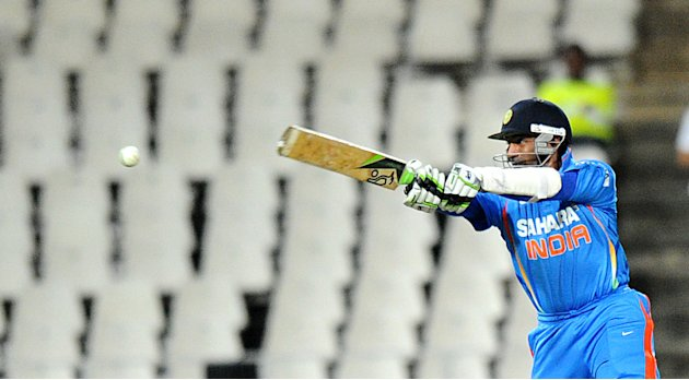 India's batsman  Robin Uthappa keeps an eye on the ball  during a one-off T20 International against South Africa for the New Age Cup in Johannesburg  at Wanderers Stadium on March 30, 2012. South Afri
