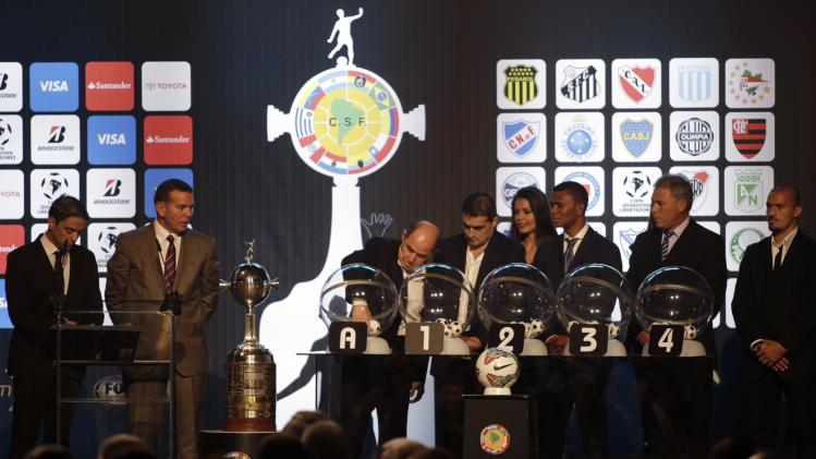 Former Argentina soccer player Hector Ricardo Bochini participates in the draw for the 2014 Copa Libertadores at the South American Football Confederation headquarters in Luque