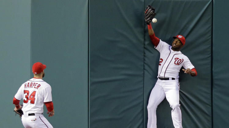 Washington Nationals center fielder Denard Span (2) cannot catch a two-RBI double hit by St. Louis Cardinals' Allen Craig as left fielder Bryce Harper (34) comes in to help during the third inning of a baseball game at Nationals Park, Monday, April 22, 2013, in Washington. (AP Photo/Alex Brandon)
