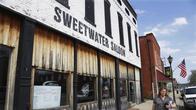 """In this April 10, 2013 photo, the Sweetwater Saloon dominates main street, taking up most of the block in Golconda, Ill. John Towns, owner of the Sweetwater Saloon says oil drilling would not bother him a bit. Southern Illinoisans have hopes and fears surrounding the high-volume oil and gas drilling that may be starting in the Shawnee National Forest. Many people are beginning to brace for change as state lawmakers consider regulations that would allow energy companies to begin drilling deep in the southern Illinois bedrock for oil and natural gas, using a process known as high-volume hydraulic fracturing, or """"fracking,"""" that has transformed the landscape in places like North Dakota and Pennsylvania. (AP Photo/Seth Perlman)"""