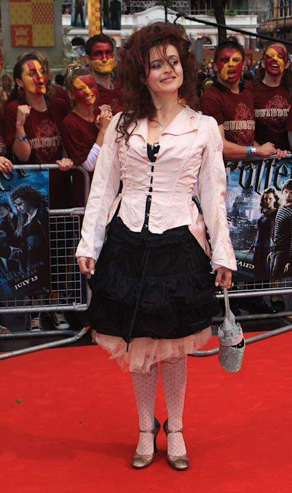Helena in a pink and black ensemble