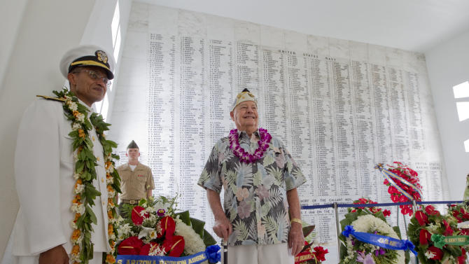 Admiral Cecil D. Haney, Commander, U.S. Pacific Fleet, poses for a picture with Pearl Harbor and USS Arizona survivor Lou Conter of Grass Valley, Calif. in the shrine room of the USS Arizona Memorial Friday, Dec. 7, 2012, at Pearl Harbor, Hawaii. Conter was on board the USS Arizona when it came under attack by the Japanese Dec. 7, 1941. (AP Photo/Eugene Tanner)