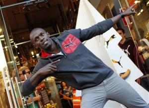 File photo of Jamaica's double Olympic champion sprinter Usain Bolt striking a pose while inaugurating a Puma store in Barcelona