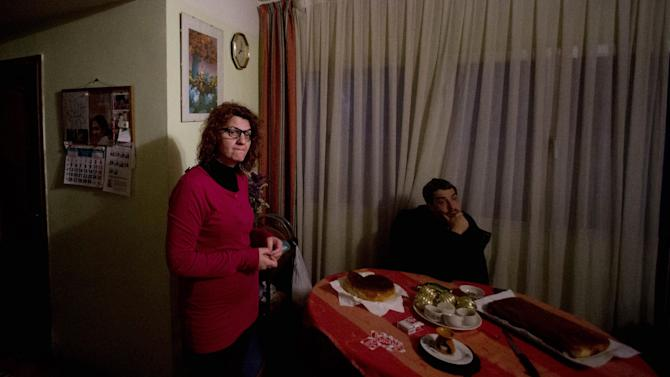 FILE In this Nov. 19, 2012 file photo, 45-year old office manager Irene Gonzalez of Spain, left waits with a friend, to be evicted from her home in Madrid. Irene Gonzalez is a domestic violence victim, works half-time because of layoffs at her air conditioning employer and is a single mother caring for her two children at the small apartment she and her ex-husband bought during Spainís economic boom years. These factors that should prevent her from being kicked out under a new Spanish decree aimed at protecting the needy from being made homeless after at least two economically desperate Spaniards facing eviction committed suicide.  Even if Gonzalez manages to stay in her home for a few more years, she still faces debt in unpaid mortgage principle, court fees and interest totaling close to euro140,000 that she and her ex-husband will owe for the rest of their lives. If they don't pay it off, their children inherit it. After putting in place the decree, Spain is now under increasing pressure to come up with a first-of-its kind insolvency law for the country that would allow mortgage debtors to turn in their keys and face limited liability. (AP Photo/Paul White, File)