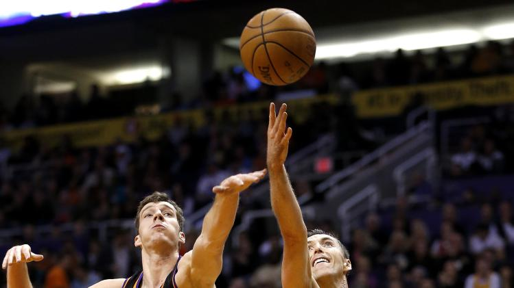 Los Angeles Lakers' Steve Nash (10) shoots next tp Phoenix Suns' Goran Dragic, of Slovenia, during the first half on an NBA basketball game, Wednesday, Jan. 30, 2013, in Phoenix. (AP Photo/Matt York)