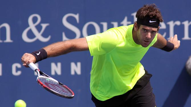 Juan Martin del Potro, of Argentina, returns a volley to Jeremy Chardy, of France, during a match at the Western & Southern Open tennis tournament, Friday Aug. 17, 2012, in Mason, Ohio. (AP Photo/Tom Uhlman)