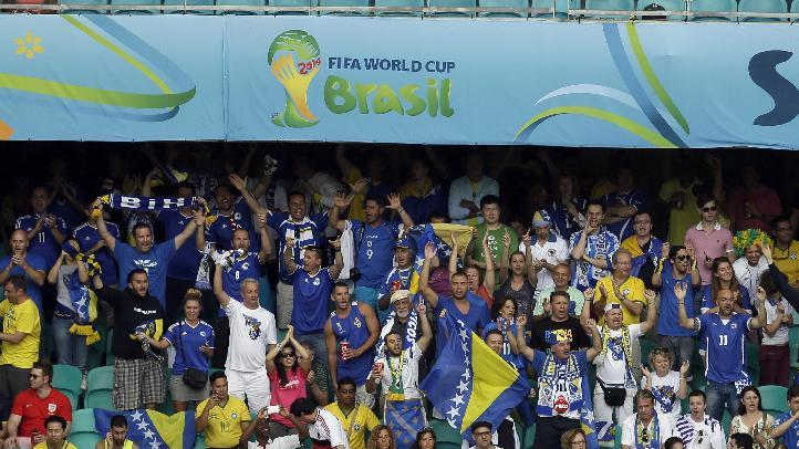 Bosnia fans cheer during the second half of a group F World Cup soccer match against Iran at the Arena Fonte Nova in Salvador, Brazil, Wednesday, June 25, 2014