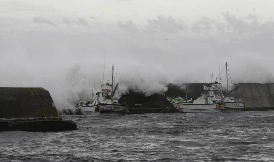Powerful typhoon downgraded after lashing Japan