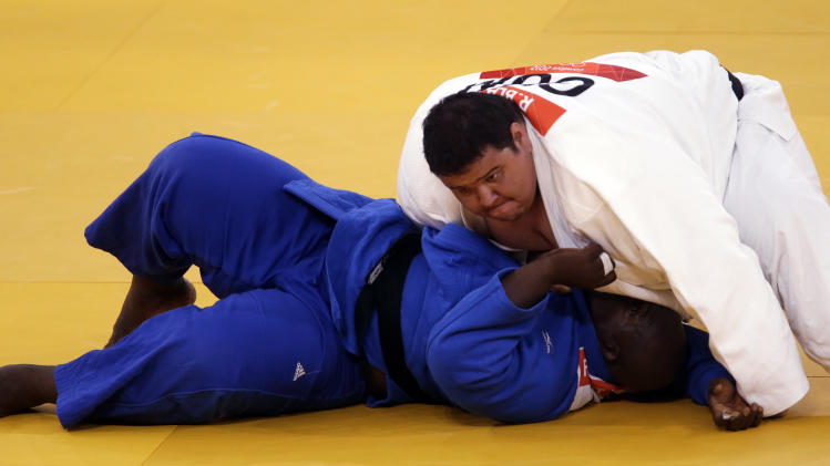 Guam's Ricardo Blas Jr. and Guinea's Facinet Keita compete during the men's 100-kg judo competition at the 2012 Summer Olympics, Friday, Aug. 3, 2012, in London. (AP Photo/Mike Groll)