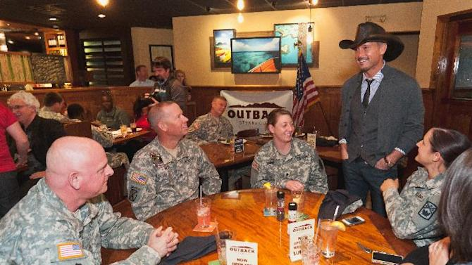 November 8, 2012, (left to right) Sargent John Davidson, Sargent Kenneth Best, Specialist Lauren Travis, Specialist Hannah Tart and Nichole Cox  speak with Tim McGraw during the Operation Homefront luncheon for Nashville area military personnel at Outback Steakhouse in Brentwood, TN.(Dean Dixon/AP Images for Outback)