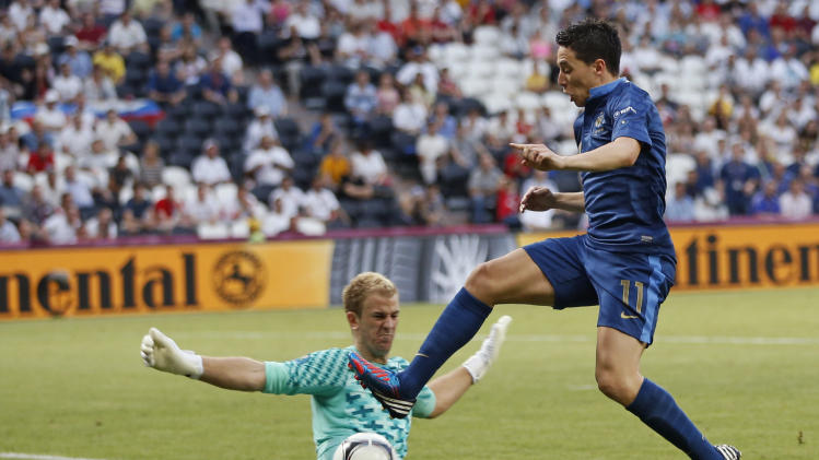 England goalkeeper Joe Hart saves in front of France's Samir Nasri during the Euro 2012 soccer championship Group D match between France and England in Donetsk, Ukraine, Monday, June 11, 2012. (AP Photo/Matthias Schrader)