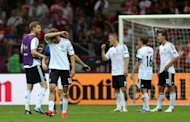 Germany players show their dejection after the final whistle