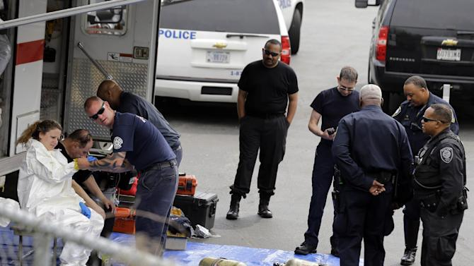 A Prince George's County, Md. firefighter, left, gets dressed in a protective suit before going into a government mail screening facility in Hyattsville, Md., Wednesday, April 17, 2013. Police swept across the U.S. Capitol complex to chase a flurry of reports of suspicious packages and envelopes Wednesday after preliminary tests indicated poisonous ricin in two letters sent to President Barack Obama and a Mississippi senator.  (AP Photo/Alex Brandon)