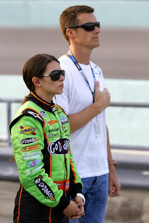 HOMESTEAD, FL - NOVEMBER 20:  Danica Patrick, driver of the #7 GoDaddy.com Chevrolet, stands with her husband Paul Hospenthal prior to the NASCAR Nationwide Series Ford 300 at Homestead-Miami Speedway