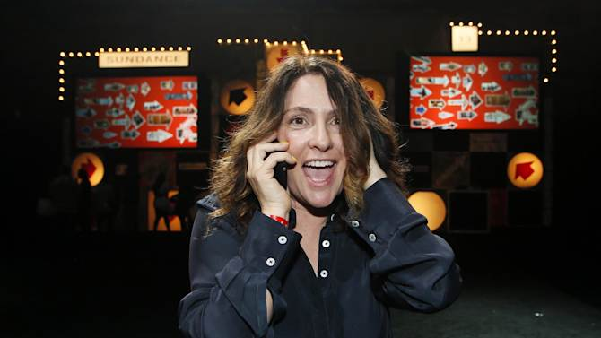 """Director Jill Soloway celebrates as she talks to her son Isaac on the phone after winning the U.S. Dramatic Directing Award for the film """"Afternoon Delight"""" during the 2013 Sundance Film Festival Awards Ceremony on Saturday, Jan. 26, 2013 in Park City, Utah. (Photo by Danny Moloshok/Invision/AP)"""