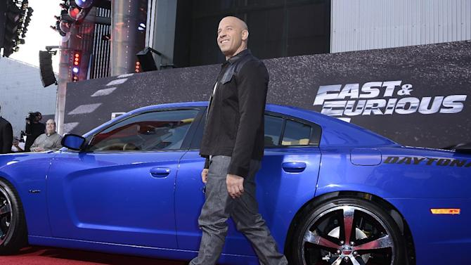 """Actor Vin Diesel arrives at the LA Premiere of the """"Fast & Furious 6"""" at the Gibson Amphitheatre on Tuesday, May 21, 2013 in Universal City, Calif. (Photo by Dan Steinberg/Invision/AP)"""